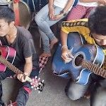Narayang and Bikram playing guitar